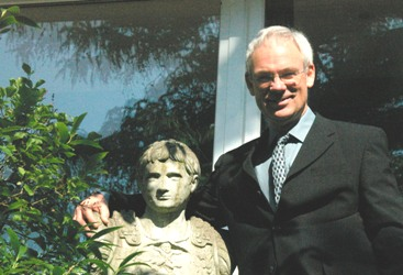 Photo of Ross Burgess with a bust of Augustus